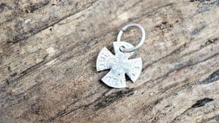 norse christian cross made from a pewter coin of canute supplied with waxed faux leather cord
