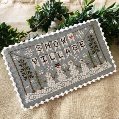 Country Cottage Needleworks Snow Village Banner - Snow Village cross stitch chart